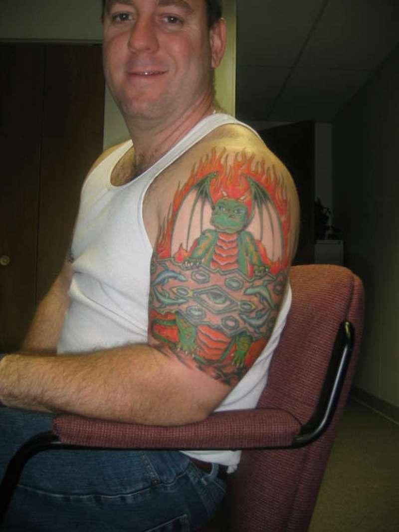 half sleeve dragon cartoon tattoo for men tattoos book tattoos designs. Black Bedroom Furniture Sets. Home Design Ideas