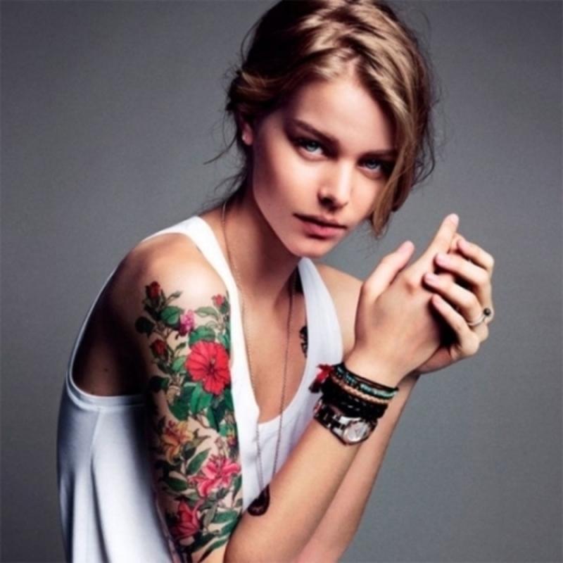 Half sleeve flowers tattoo design for girls