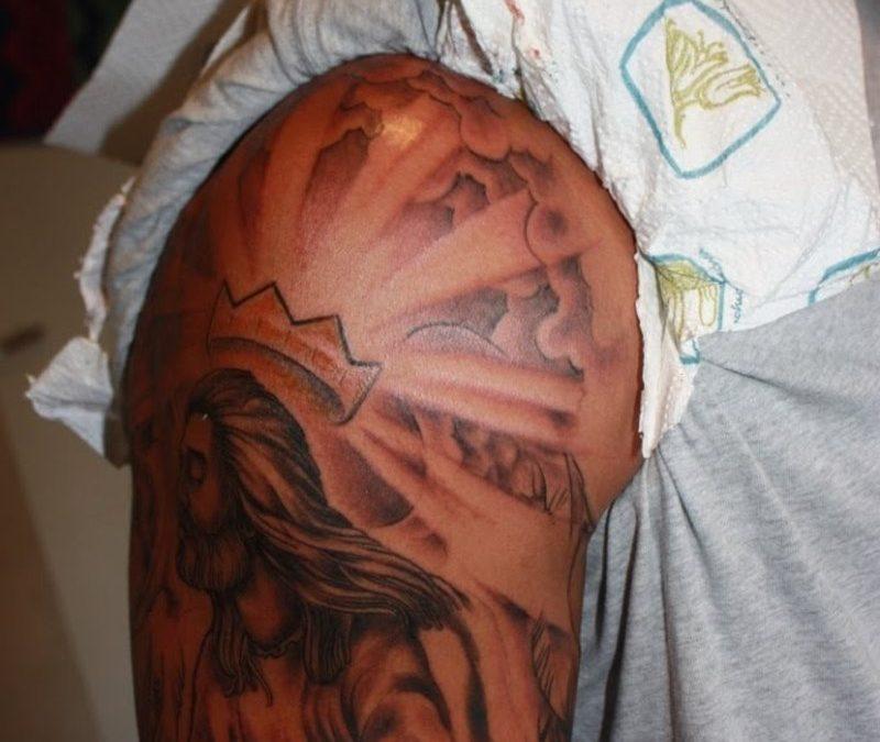 Half sleeve jesus tattoo design