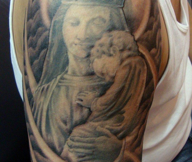 Half sleeve mary with jesus baby tattoo