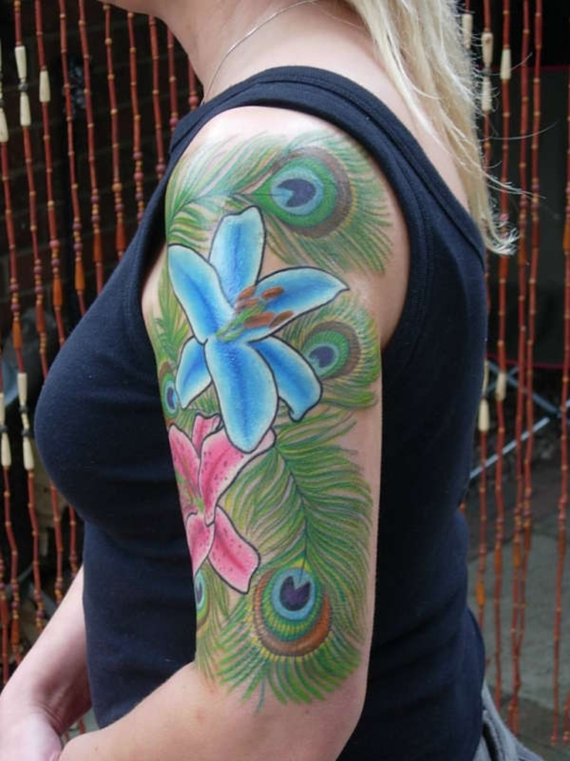 Half sleeve peacock feathers tattoo for girls