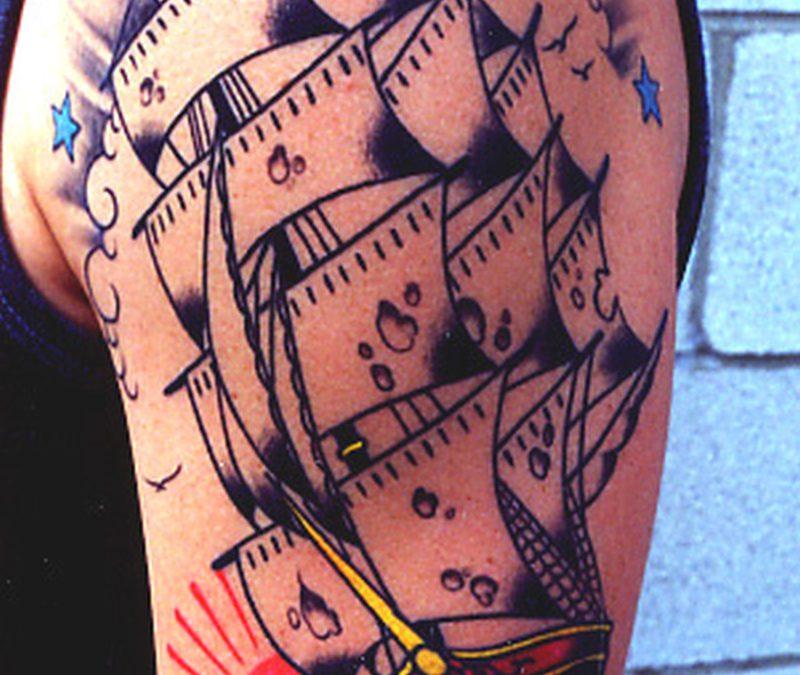 Half sleeve pirate ship tattoo design