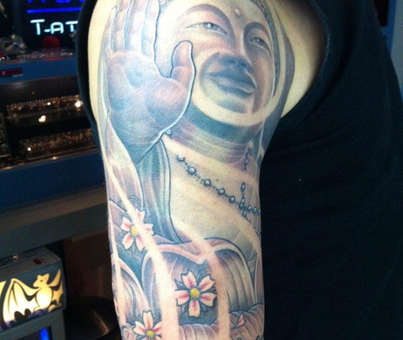 Half sleeve religious buddha flowers tattoo