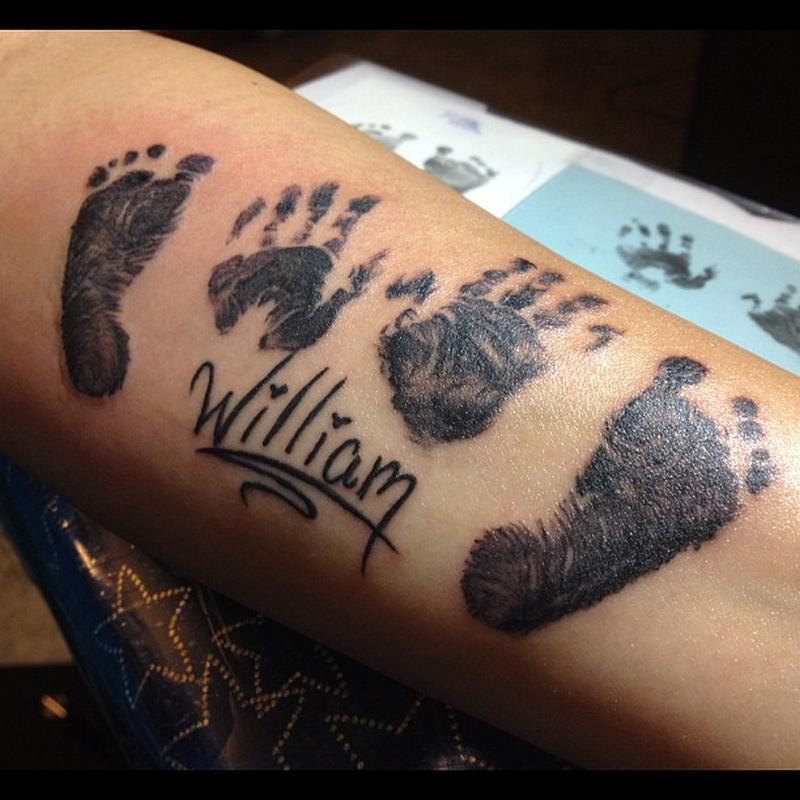 Handprints n footprints tattoo on arm