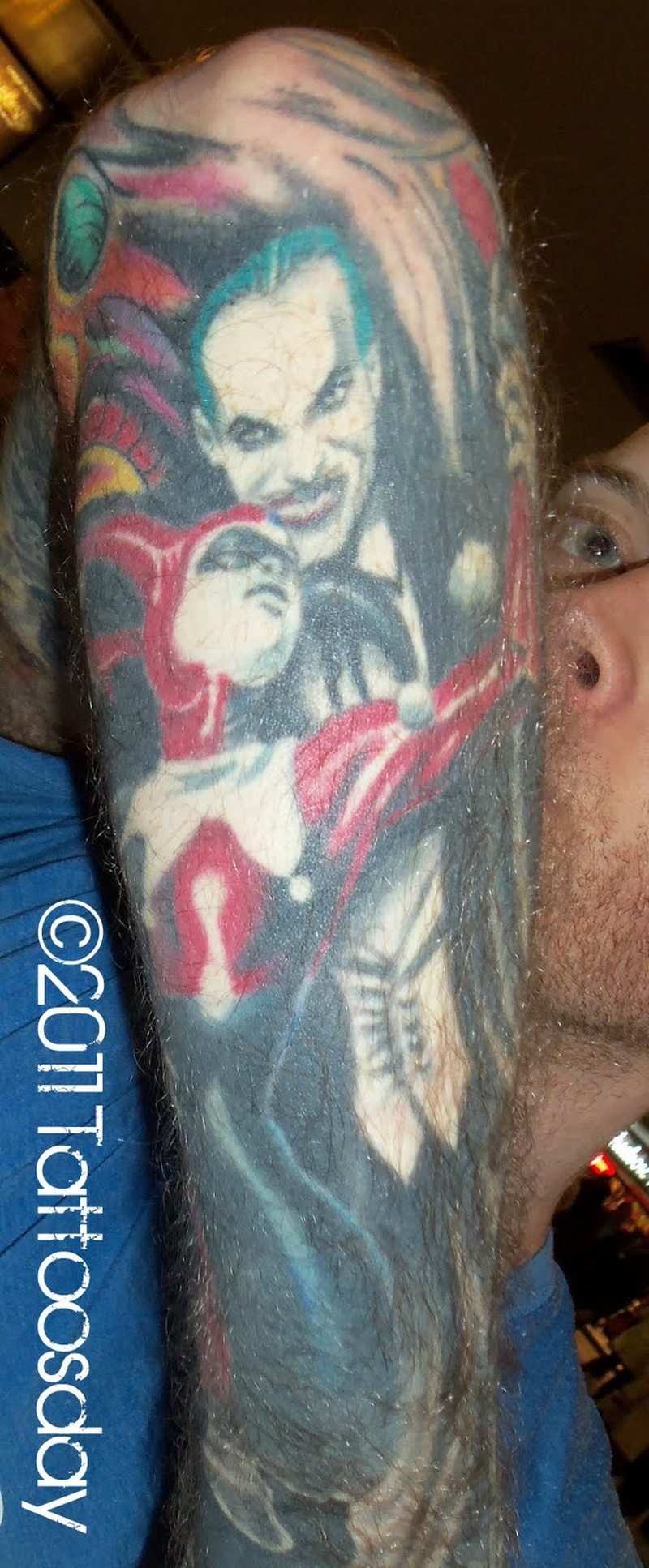 Harley joker tattoo on arm