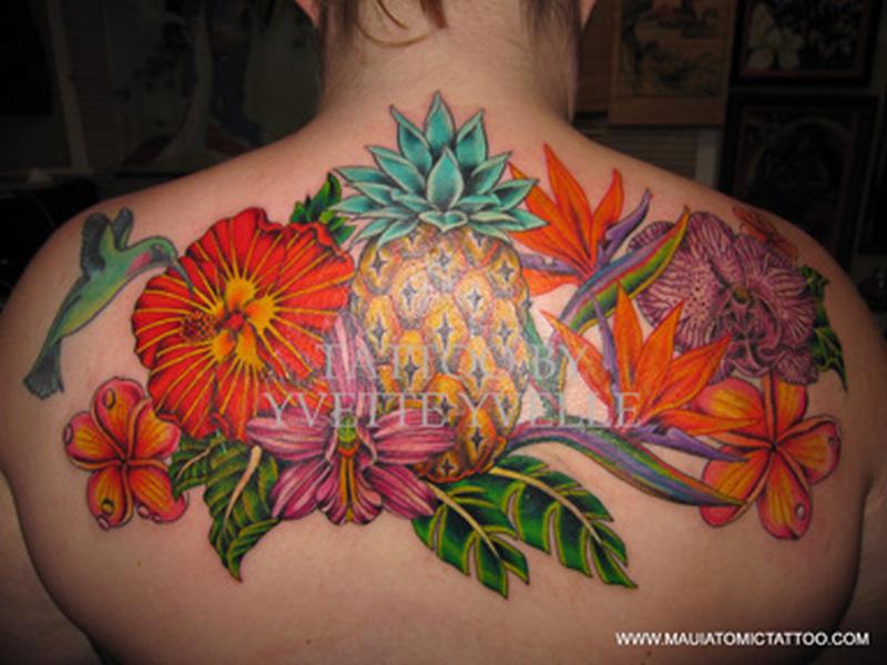 Hawaiian flowers tattoo on upper back 2