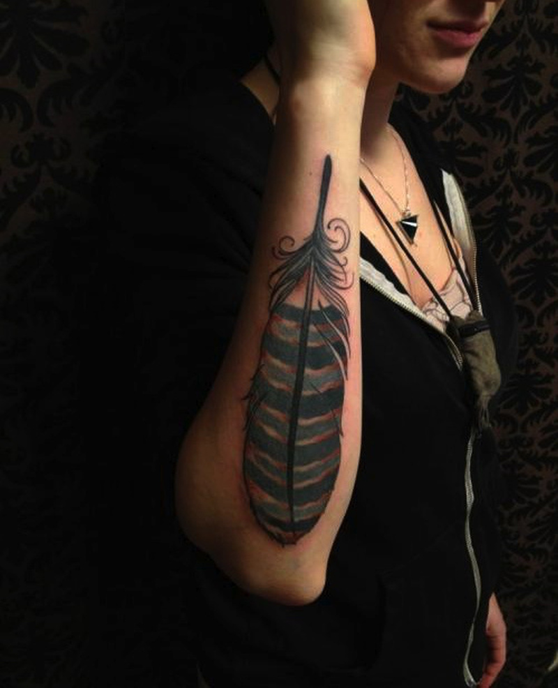 Hawk feather tattoo on arm