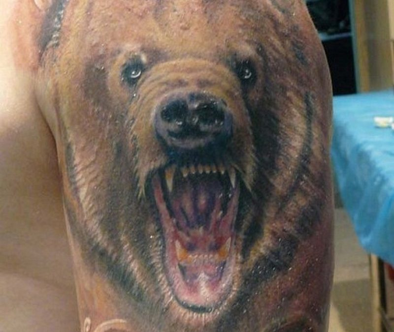 Head snarling bear with patterns tattoo on half sleeve