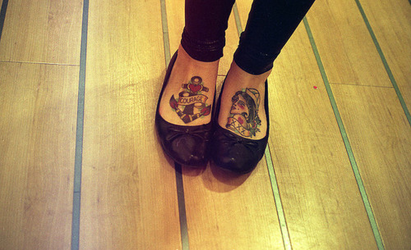 Heart anchor girl tattoo on feet