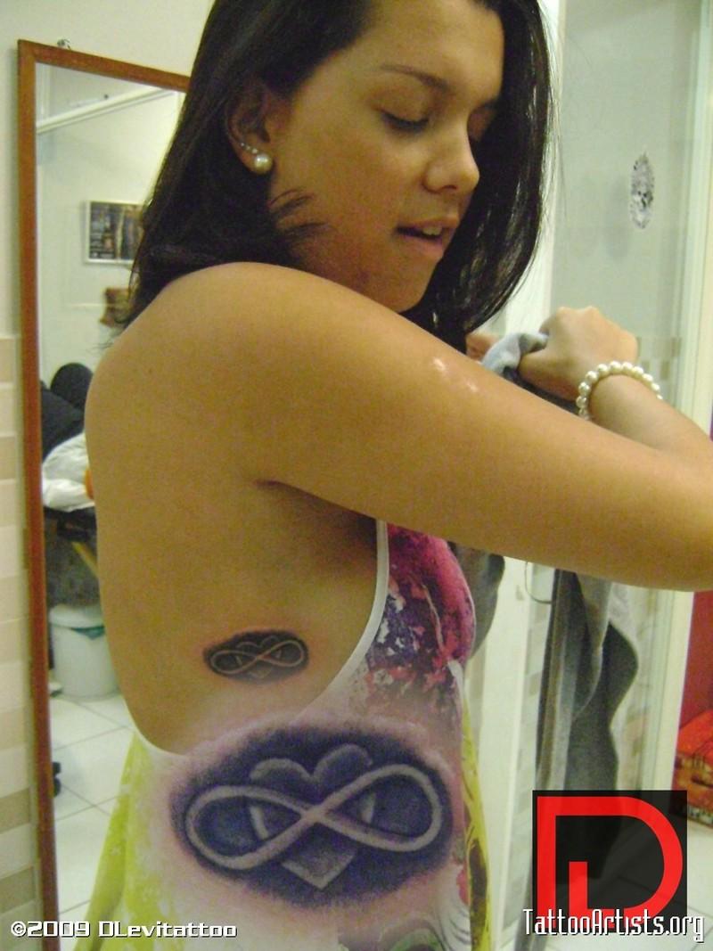 Heart n infinity tattoo on ribs