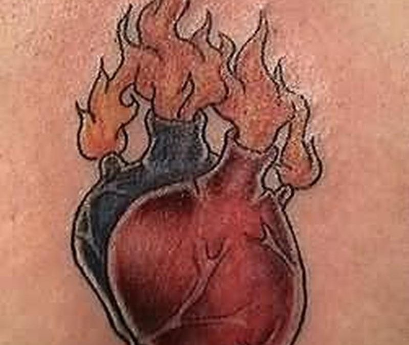 Heart volves fire n flame tattoo design