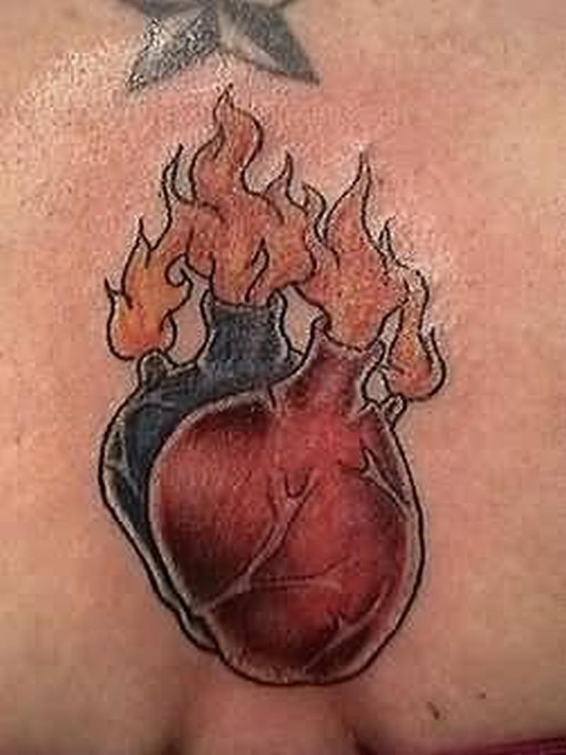 Heart volves fire n flame tattoo design