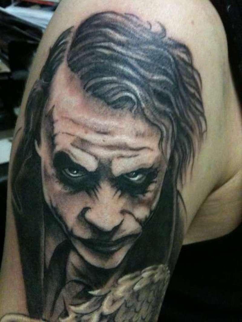Heath ledgers joker tattoo on arm
