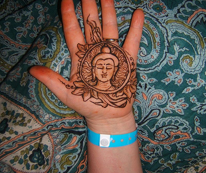 Henna buddha tattoo on palm