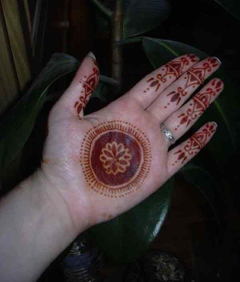Henna circle tattoo on palm