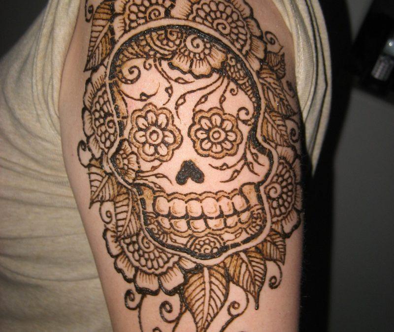 Henna sugar skull tattoo on biceps
