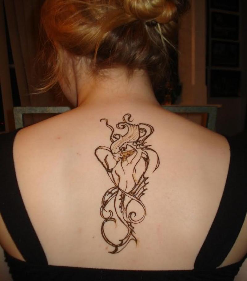 Henna tattoo on upper back for girls