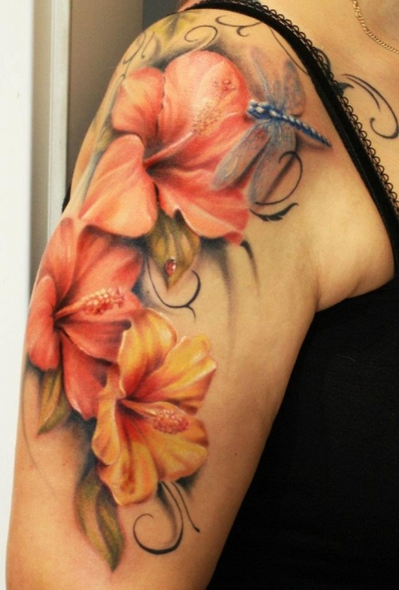 Hibiscus dragonfly tattoo on upper arm