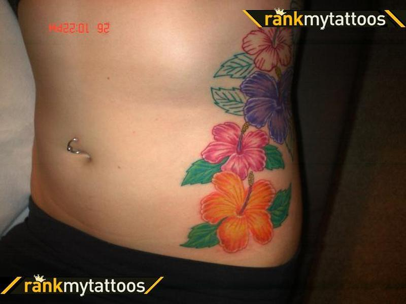 Hibiscus flower tattoo on ribs
