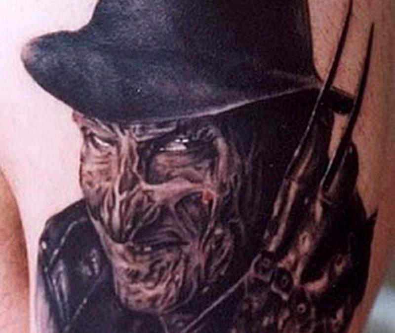 Horror freddy tattoo on upper arm