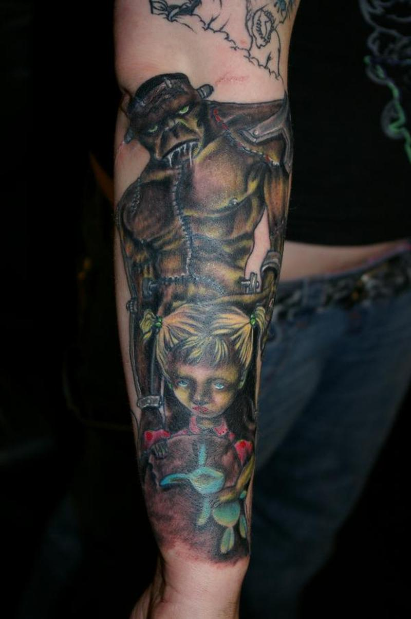 Horror tattoo on lower arm