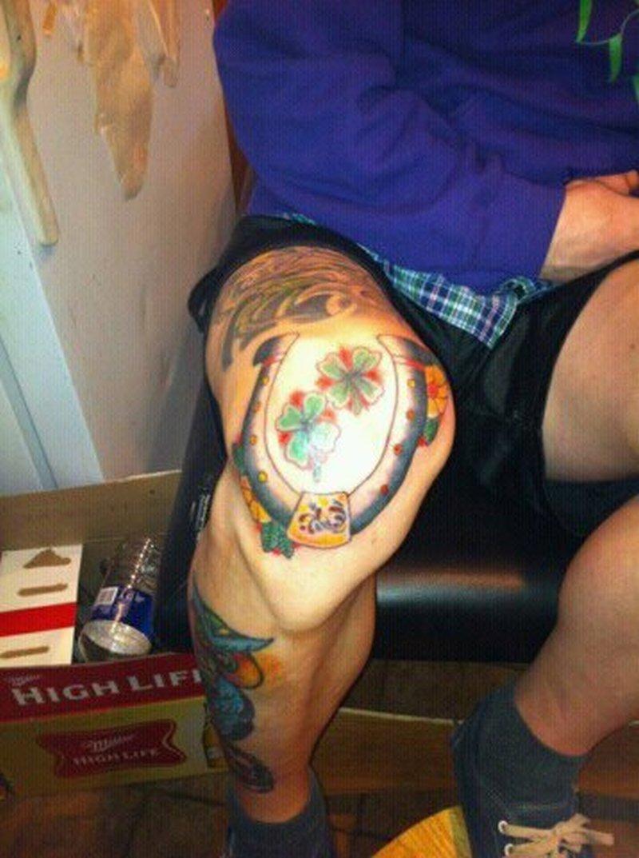 Horseshoe n clovers on left knee tattoo