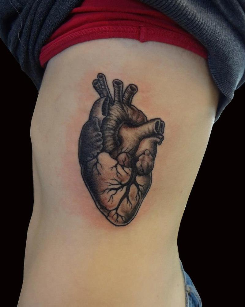 Human heart on ribs tattoo