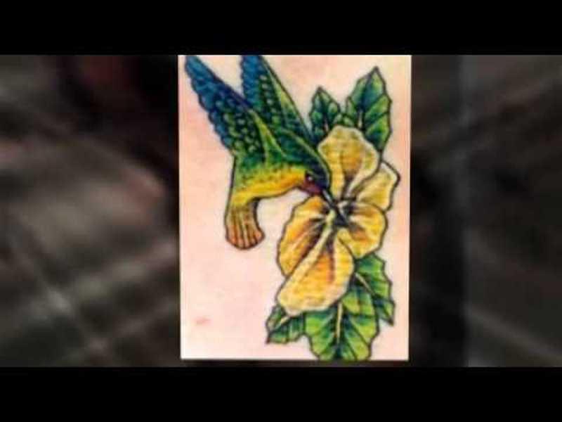 Humming bird on flower tattoo design