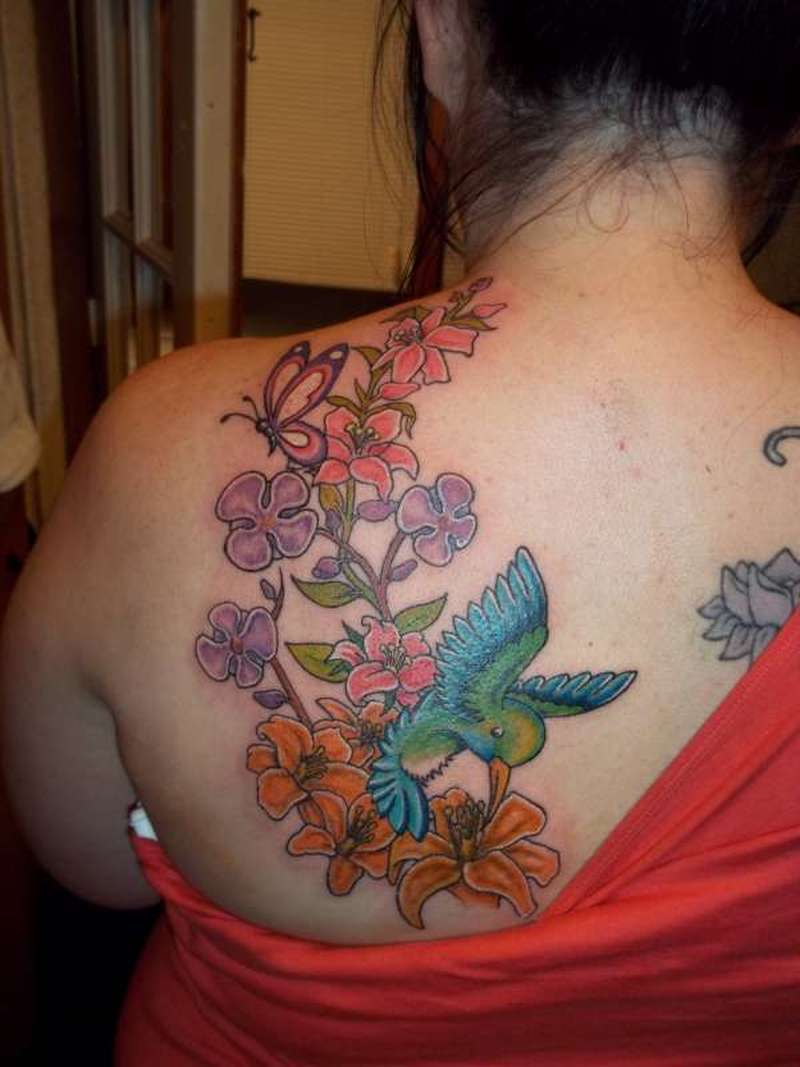 cf5b096de7783 Hummingbird lilies butterfly and orchids tattoo on back - Tattoos ...