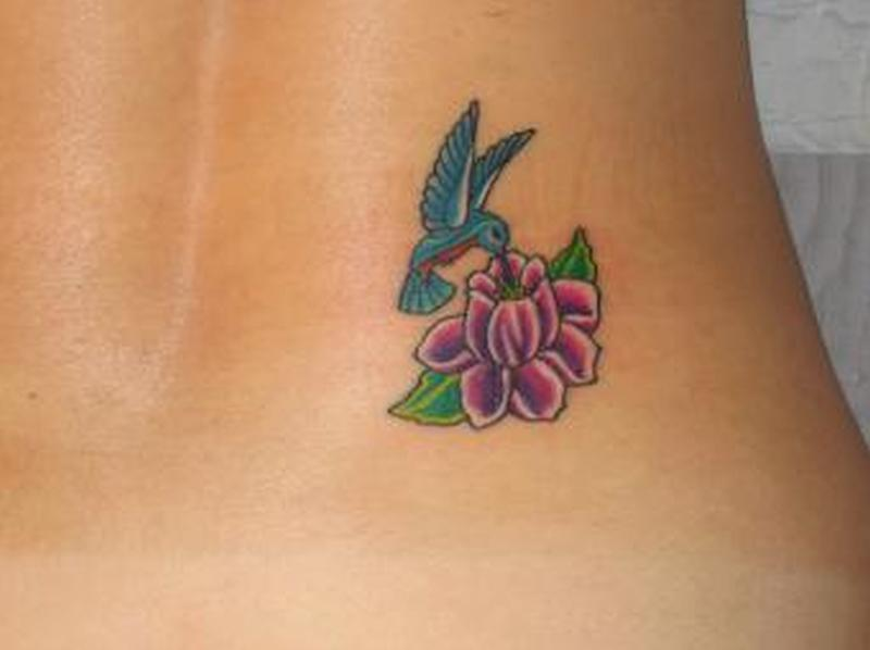 Hummingbird on flower tattoo design