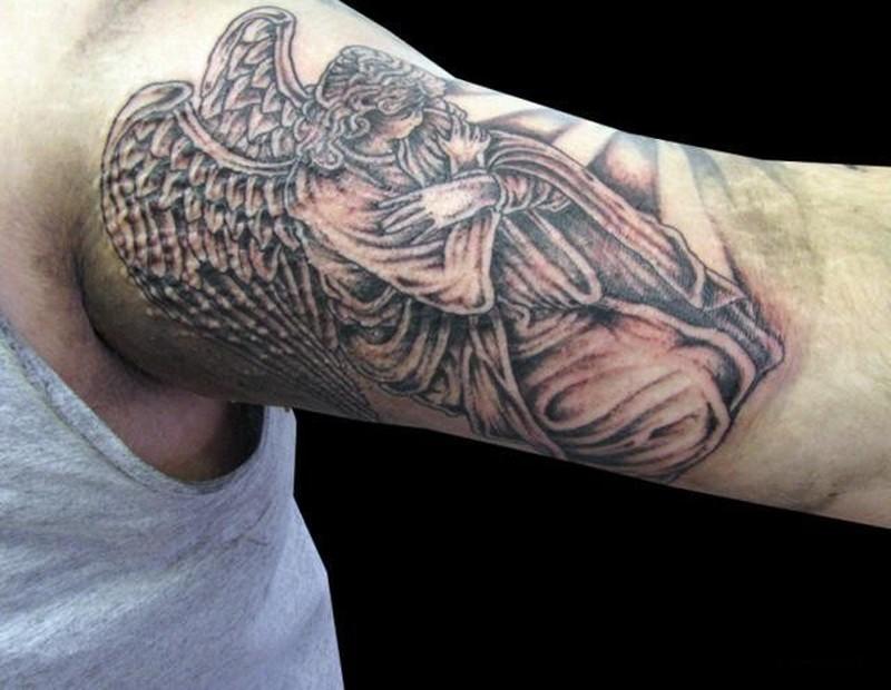Kneeling angel tattoo on half sleeve