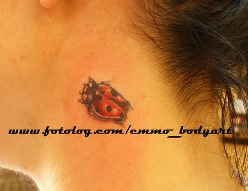 Lady bug tattoo on neck for girls