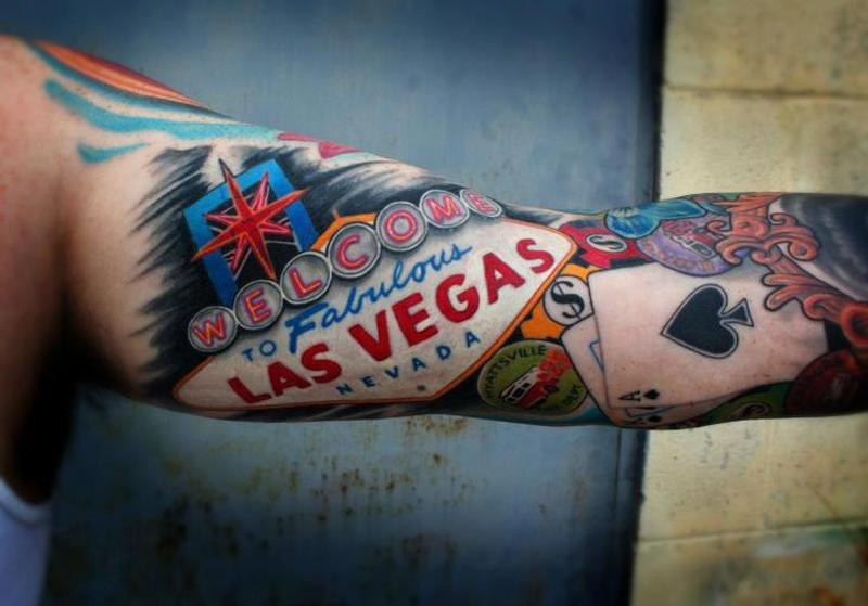 Las vegas gambling tattoo on arm