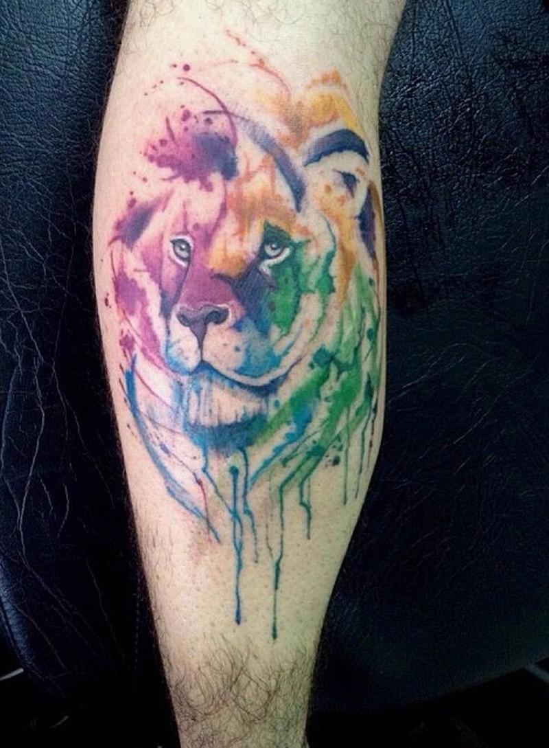 Lion watercolor tattoo on leg calf