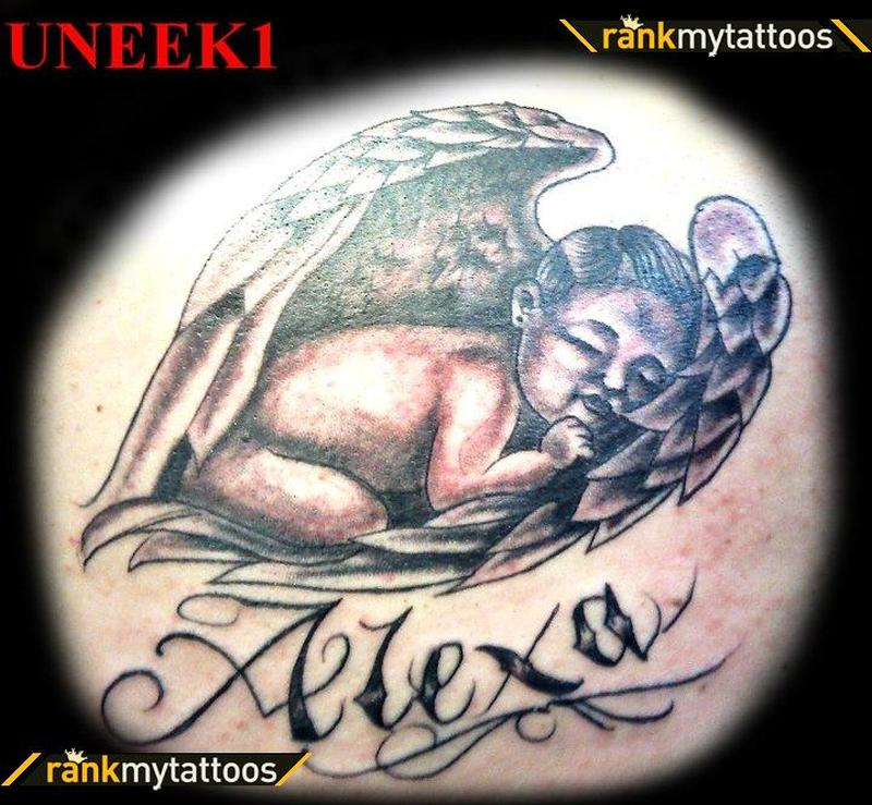 Little baby sleeping in wings design tattoo