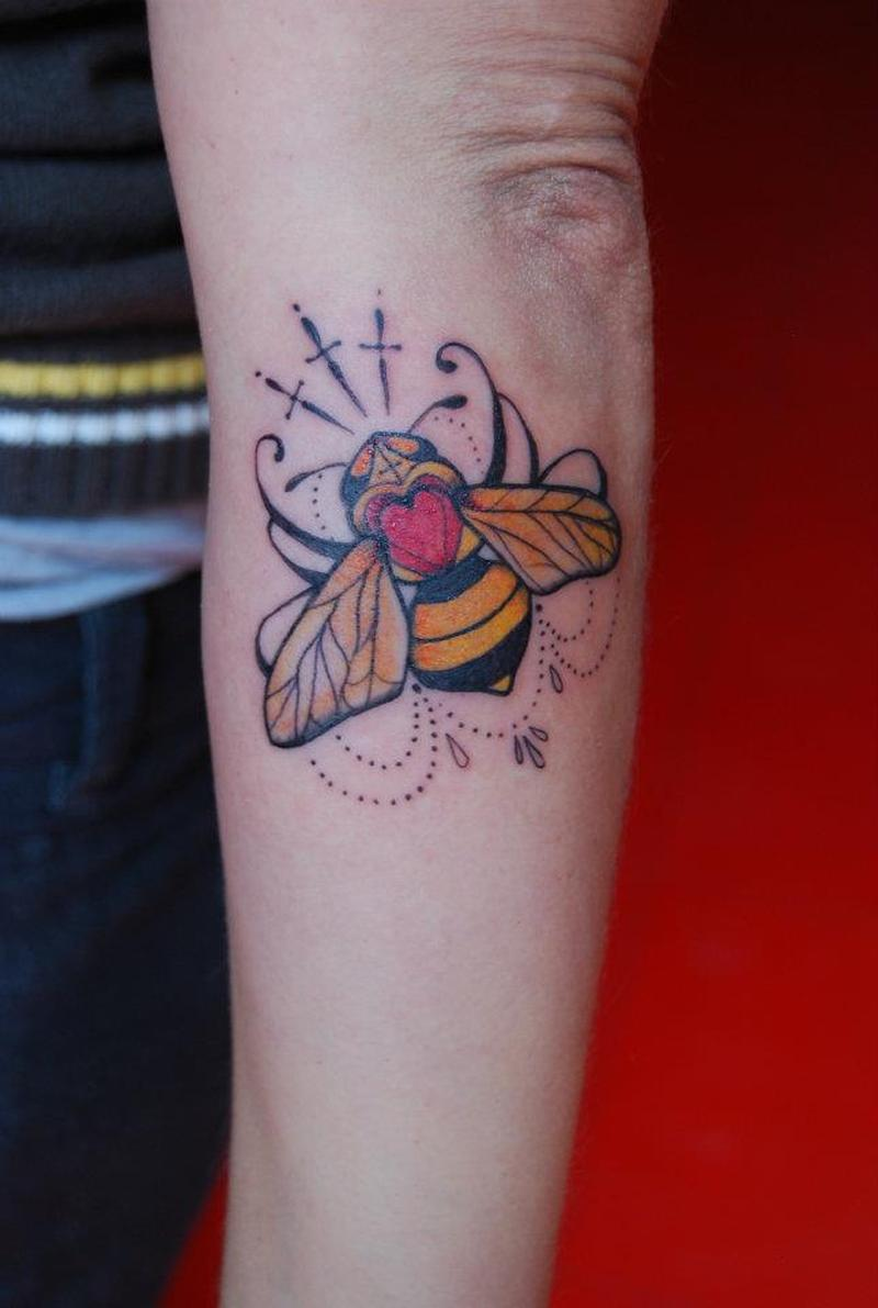 Lovely bee tattoo on forearm