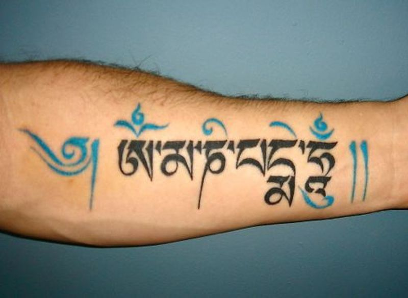 Lovely buddhist tattoo on forearm