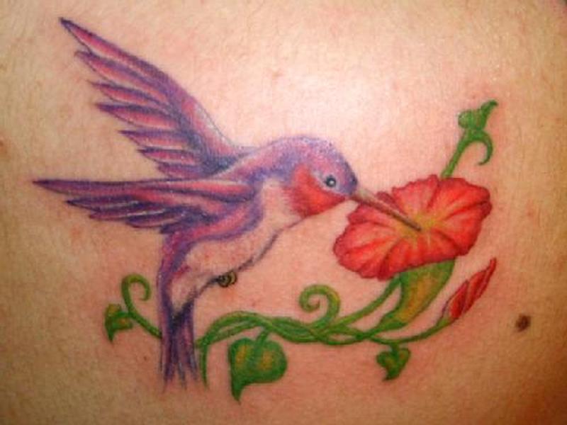 Lovely hummingbird n flower tattoo design