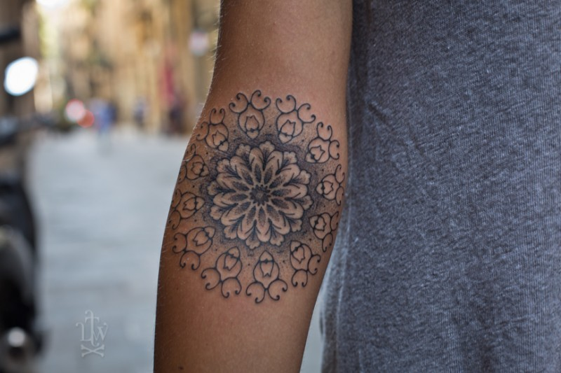 Lovely mandala forearm tattoo for women