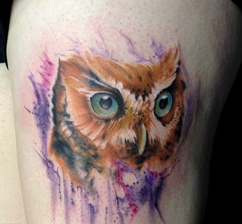 Lovely watercolor owl tattoo