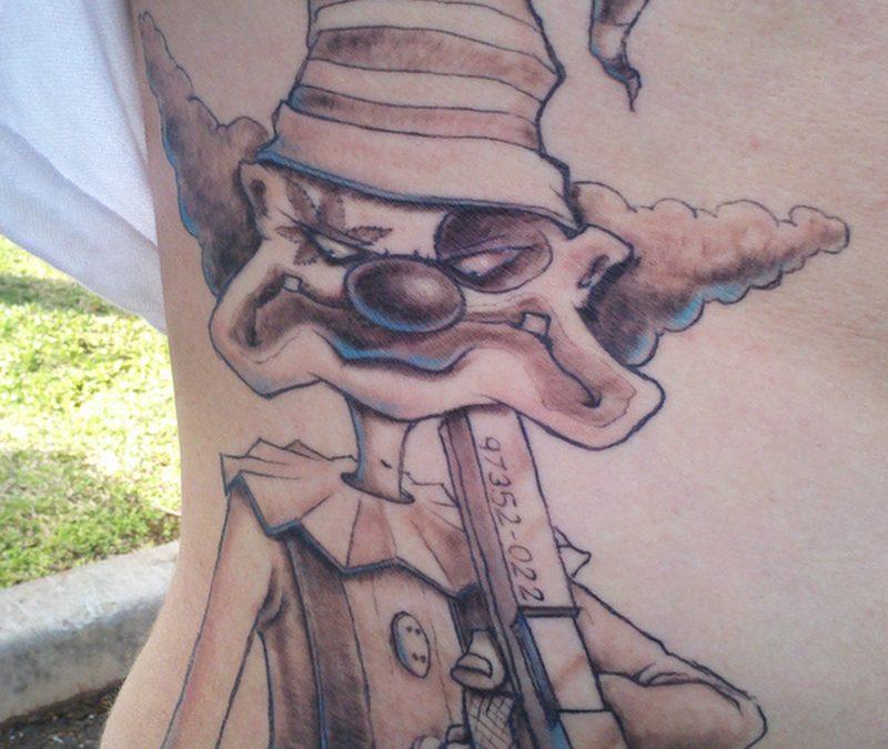 Mad clown tattoo on rib side
