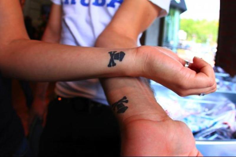 Matching danger sign couple tattoo design