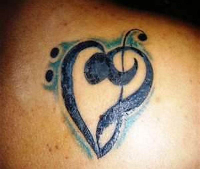 Matching love tattoo for couples