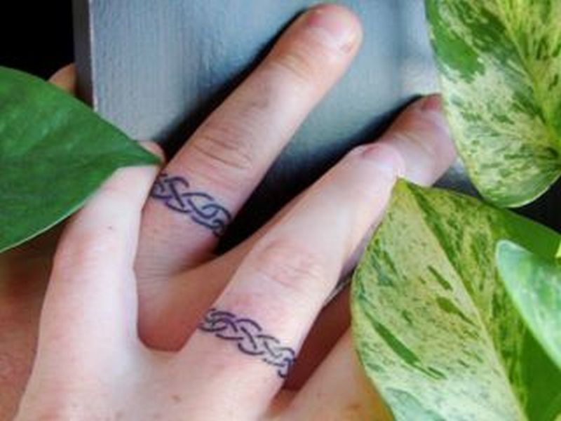 Matching rings tattoo for couples