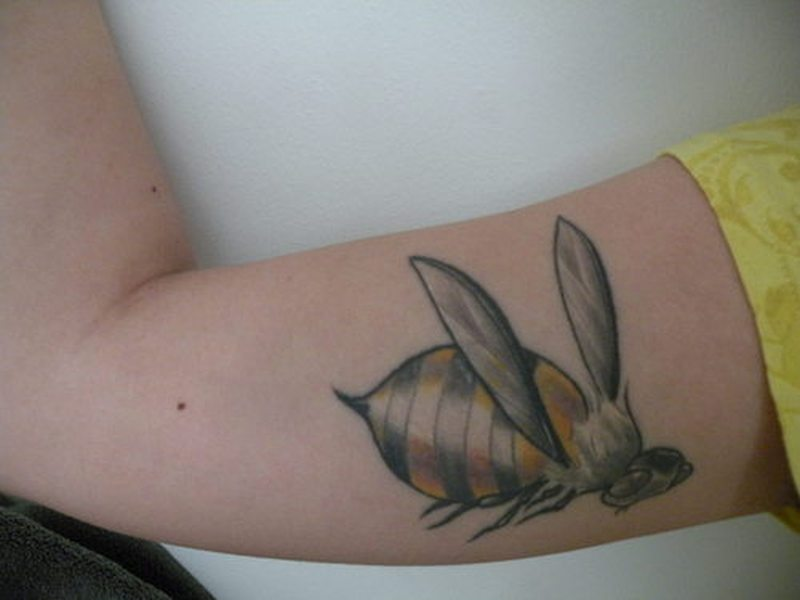 Muscles bumblebee tattoo design