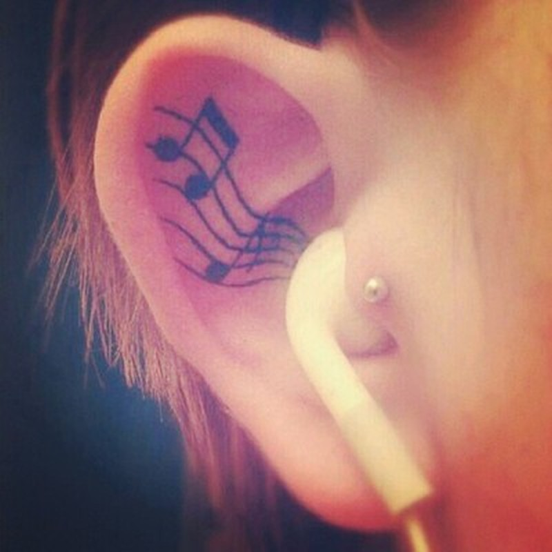 Music notes tattoo inside ear