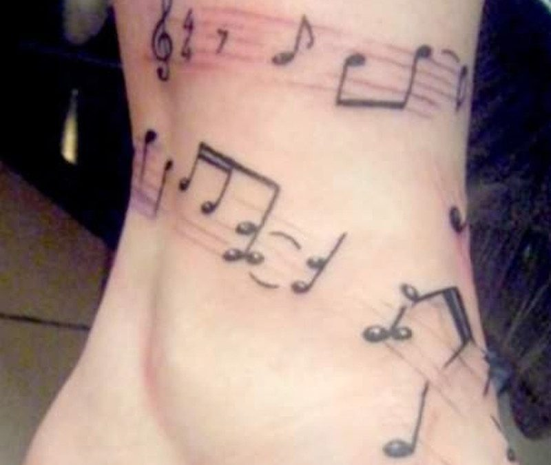 Musical band tattoo on ankle