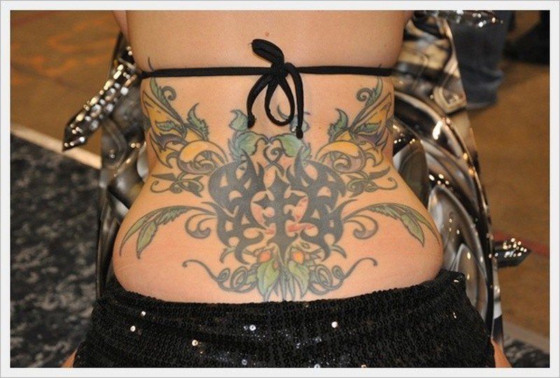 Nice floral patterns tattoo on lower back