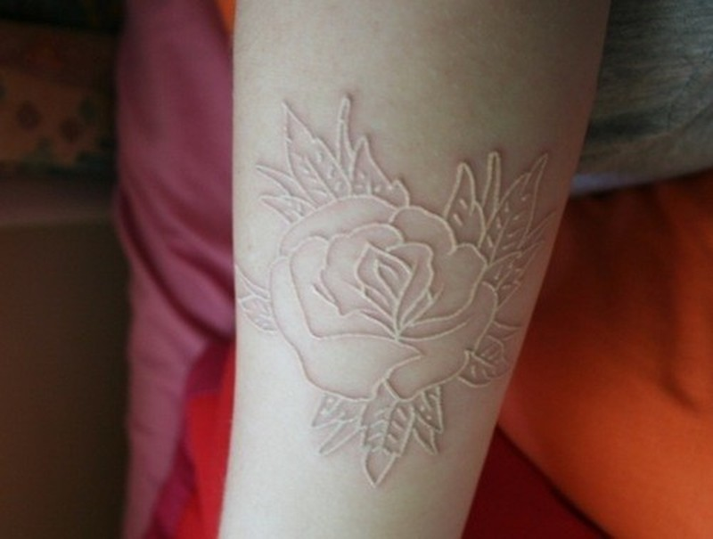 nice rose skin scarification on arm tattoo tattoos book tattoos designs. Black Bedroom Furniture Sets. Home Design Ideas