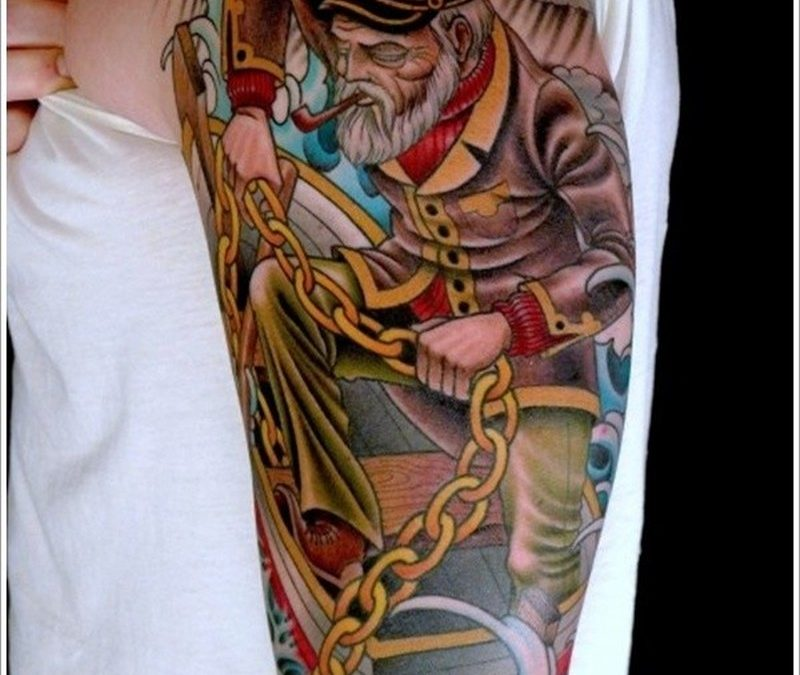 Old school old sailor with a chain tattoo on half sleeve